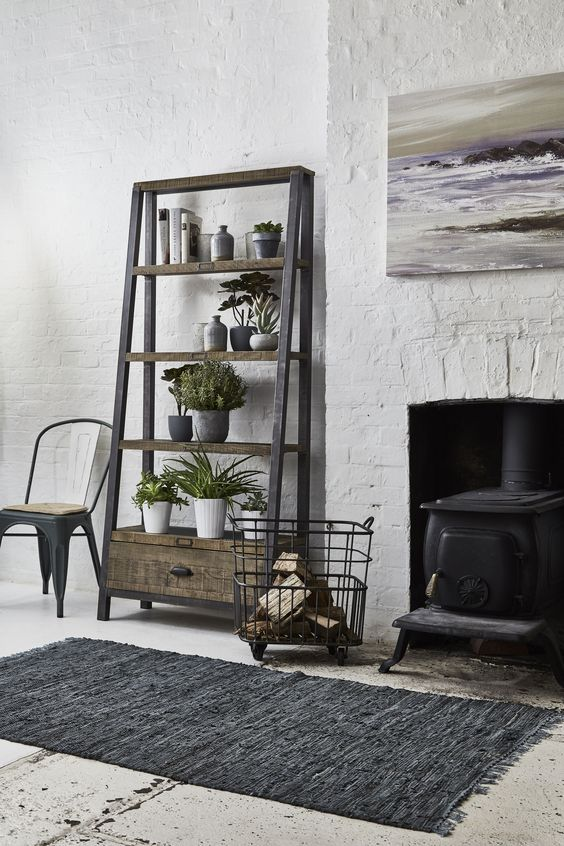 Looking for some living room inspiration? Mix natural, rustic furniture with cool coloured accessories and modern metal accents to create an on-trend urban cabin feel. Click for more ideas. #livingroom #homedecor #interiors