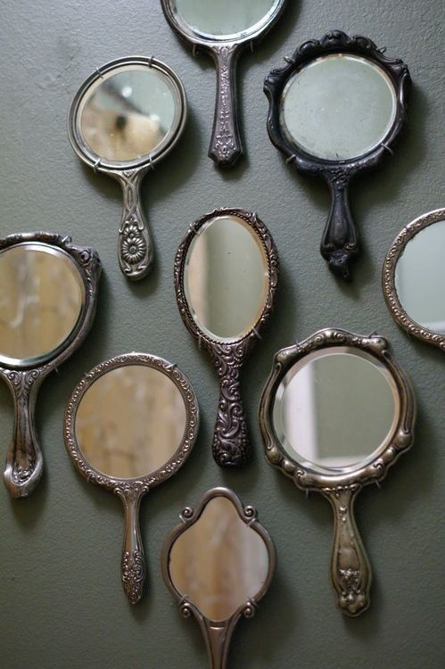 I think an antique mirror would be really cool in this apartment. A couple of these could go around the big mirror: