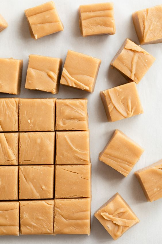 Whip up this easy peanut butter fudge recipe. It's supremely creamy! #peanutbutterfudge #peanutbutter #fudge #candy