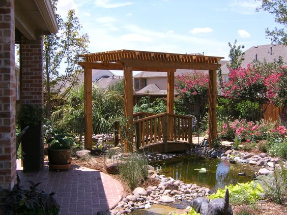Pergola arbor foot bridge over koi pond custom stone for Fish pond bridges