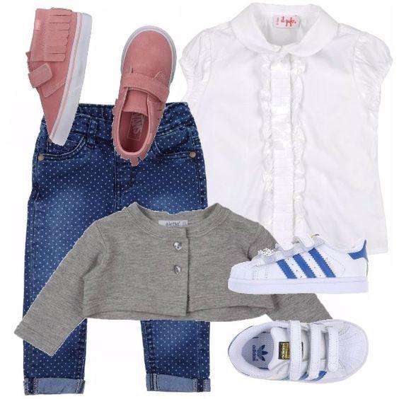 Ecco un look perfetto per le giornate sempre meno calde: jeans con piccoli pois abbinati a una camicetta bianca con ruches sul davanti e un coprispalle di colore grigio. Scarpe a scelta fra un classico abbinamento bianche/blu o un leggero rosa con frange sul tallone.