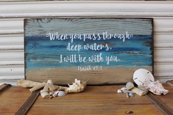 When you pass through deep waters, I will be with you, Isaiah 43:2, is painted on cedar and distressed for a weathered look. A perfect addition to your beach decor or to simply display scripture in your home! This rustic beach sign may be leaned against the wall on a shelf or mantel, or you may hang it on the wall. Painted in beachy colors, the beach sign was heavily distressed and stained on all sides. The stain enhances the wood grain! White lettering was slightly sanded, as well. Sealed…