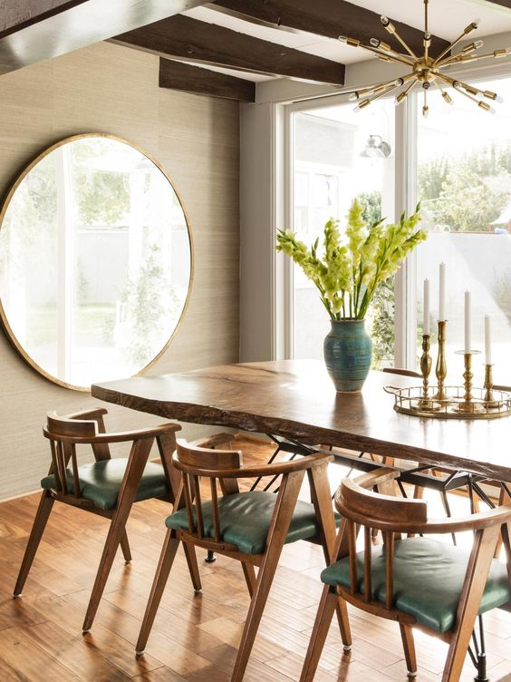 Mid-Centry Modern Dining Room with large round vintage mirror // #hgtvmagazine http://www.hgtv.com/design/decorating/design-101/inside-the-home-of-mr-and-mrs-vintage-pictures?soc=pinterest: