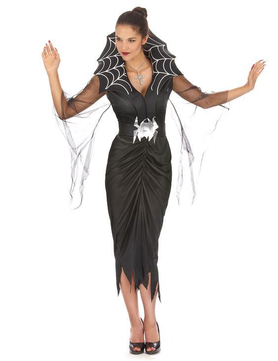 Déguisement araignée femme Halloween : Ce déguisement de femme araignée se compose d'une robe, d'un cole et d'une ceinture (chaussures, faux ongles et collier non inclus) La robe longue noire fendue a de...