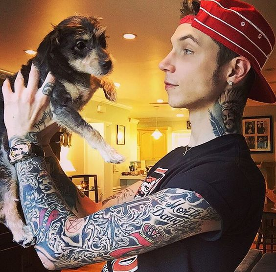 Andy Biersack with his puppy daredevil< my heart just exploded