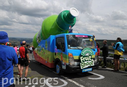 The publicity caravan makes its way to the summit as stage two of the Tour de France passes over Holme Moss Moor, Yorkshire.