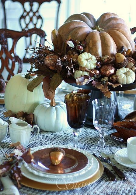 Thanksgiving table top with pumpkin centerpiece, Brown and bronze china and linens, Hepplewhite dining chairs