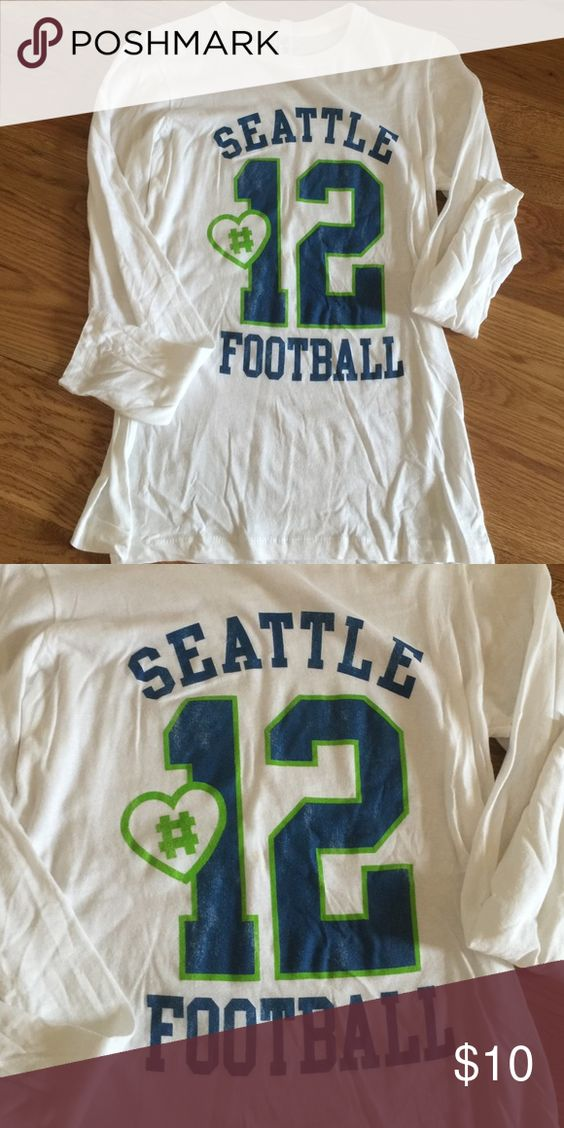 """Seahawks Football Shirt. #12. Size Medium Monday night football. If you're a Seahawks fan, this long sleeve shirt is for you. Size Medium. 18"""" armpit to armpit. 25"""" overall length. Next Level Tops Tees - Long Sleeve"""