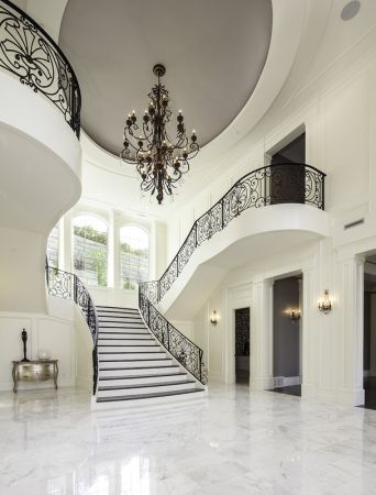 Lane Myers Construction Custom Home Builder Loeffler Residence Draper Utah Versailles Inspired Entryway White Marble Floor Grand Staircase Black Iron Banister Chandelier White Walls Mens Womens Guest Bathroom