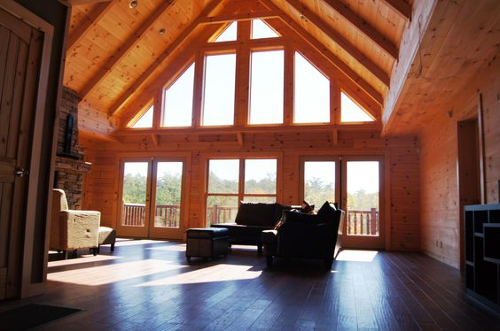 High Cathedral Ceilings And Large Windows Give The Living Room Of This Jocassee 5 A Very Open