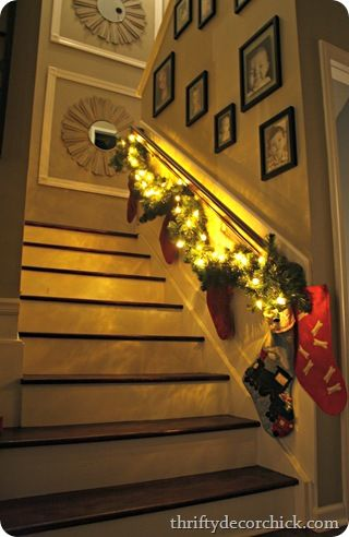 Like the framed mirrors at the top of the stairs home for Hang stockings staircase