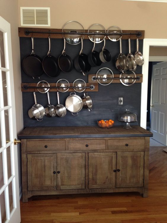 Diy wall in my kitchen i made the pot racks from black for Reclaimed wood pot rack