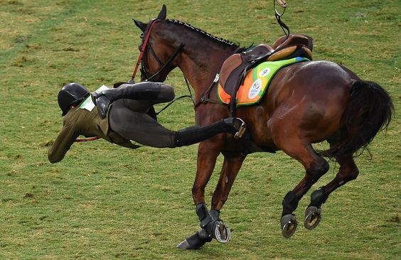 Lithuania's Justinas Kinderis is thrown from his horse in the show jumping portion of the men's modern pentathlon event at Deodoro Stadium on August 20, 2016.