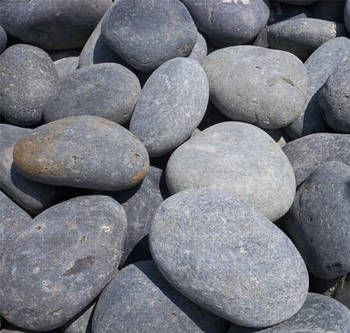 Black mexican beach pebbles are smooth flat and oval for Smooth river rocks for landscaping