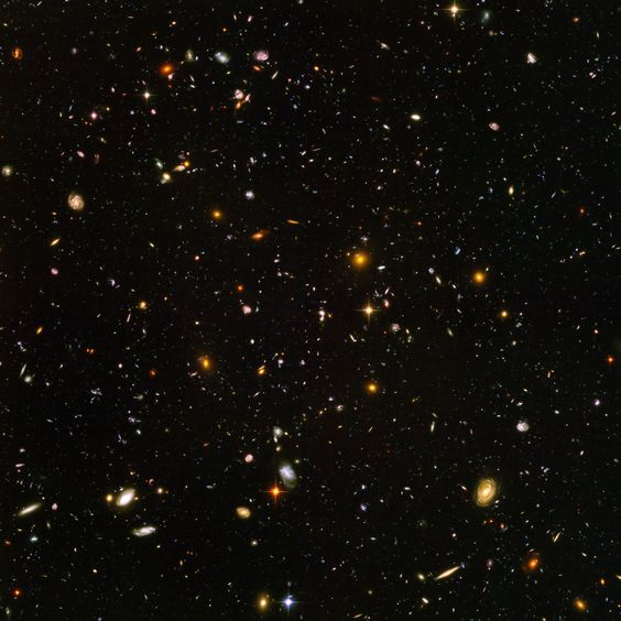 This is what happened when the Hubble Telescope stared at a section of the dark night sky for 11 days.  The area you see is one thirteen-millionth of the total sky.  In that tiny bit of the heavens you're looking at, we found over 10,000 galaxies.  Each galaxy has between ten million and 100 trillion stars.    However small you think you are, you cannot imagine how much smaller you actually are.