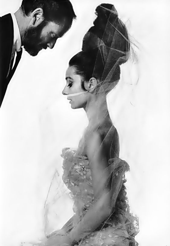 Audrey Hepburn in Givenchy, photographed with then-husband Mel Ferrer by Bert Stern for French Vogue.
