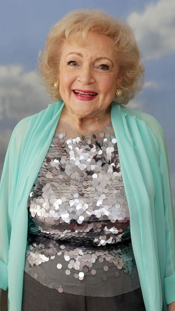 Betty White Ludden, known professionally as Betty White, is an American actress, author, producer, radio host, animal activist and television personality.She is 91 and still working!