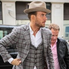 Birthday suit! Matt Goss dons a checked 3-piece suit and fedora on his birthday in London