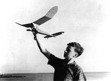13 year-old Paul MacCready with a  gas-powered model airplane.