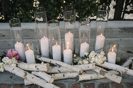 In the warmer months, repurpose the vases from your wedding to design a stunning fireplace display. Jazz up your fireplace by filling it with branches and large glass vases storing candles.