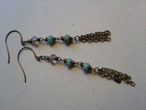 Free spirited  Bohemian  Mother Daughter Lover of life  At the end of this earring is three lengths of chain giving it a feathered effect. Each section is wire wrapped and the colors featured are topaz and turquoise.  Topaz crystal rondelle measures 6mm. Turquoise glass bead has some brow...