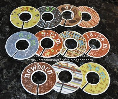Closet dividers - Old CDs or DVDs with a bit cut out. Cute baby Gift