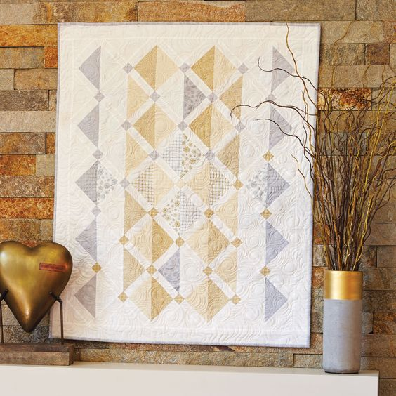 MAKE NEW FRIENDS by Wendy Sheppard: Pair classic silver and gold for a beautiful wall hanging quilt. To create this pretty wall hanging, Wendy Sheppard used triangles that seem to float!
