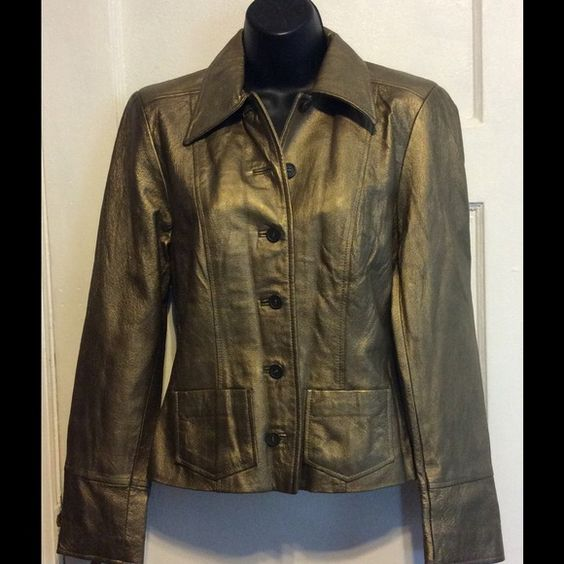 Finity Studio Gold colored leather jacket size 2 Finite Studio Gold Leather Jacket size 2 fully lined like new condition. Measures 36 bust   Measures 23 inches from top shoulder to bottom hem. Sleeves 24 inches long. And 14 inches wide. Create the look shown in pic Finity Studio Jackets & Coats