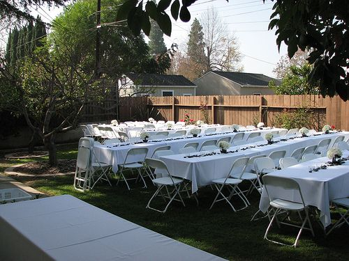 Simple Long Tables With Folding Chairs Make Perfect Reception Seating For A Backyard Vow Renewal