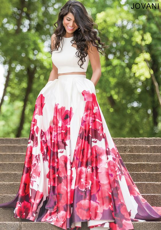 Stunning two-piece sleeveless dress features a multicolored floral print A-line skirt