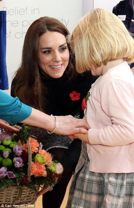 The Duchess of Cambridge is presented with a bouquet of flowers by Tilly Penhale, aged four from Cheltenham during her visit: