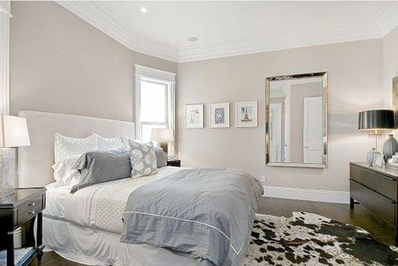 wall color: Benjamin Moore's Grege Avenue, bedding: Bloomingdales, mirror: Restoration Hardware.