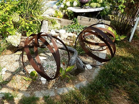 wine barrel rings made into garden orbs Things I made