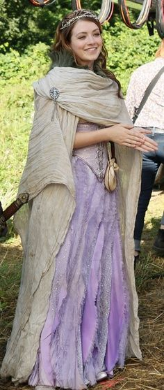 I love Aurora's costume on OUAT. Since the Disney version of Sleeping Beauty wears both blue and pink, they combined those and went with purple. Genius!