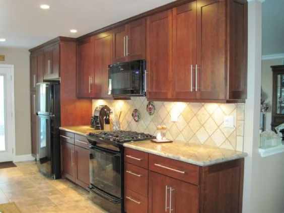 Black appliance kitchen cherry cabinets and tile on pinterest for Kitchen cabinet colors with black appliances