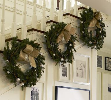 Wreaths on stairs -- love this!