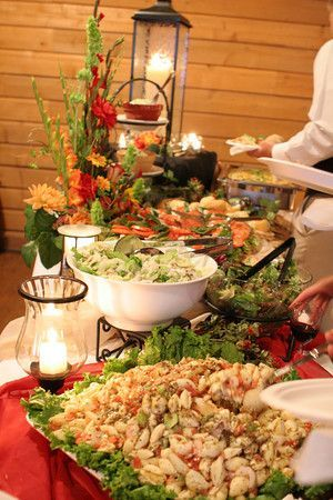 Different levels on the buffet create a beautiful food display Use tulle, or bunched up cloths to add color. Also, use the lanterns and candle globes  http://www.vintagevinylcds.com/