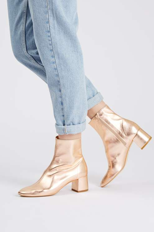 Choose a distinctive style when it comes to the ankle boot with this soft leather pair. Detailed with in a chic all-over metallic gold leather, we love the practical mid-heel and softly pointed toe. #Topshop