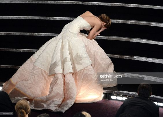 Actress Jennifer Lawrence reacts after winning the Best Actress award for 'Silver Linings Playbook' during the Oscars held at the Dolby Theatre on February 24, 2013 in Hollywood, California.  (Photo by Kevin Winter/Getty Images)