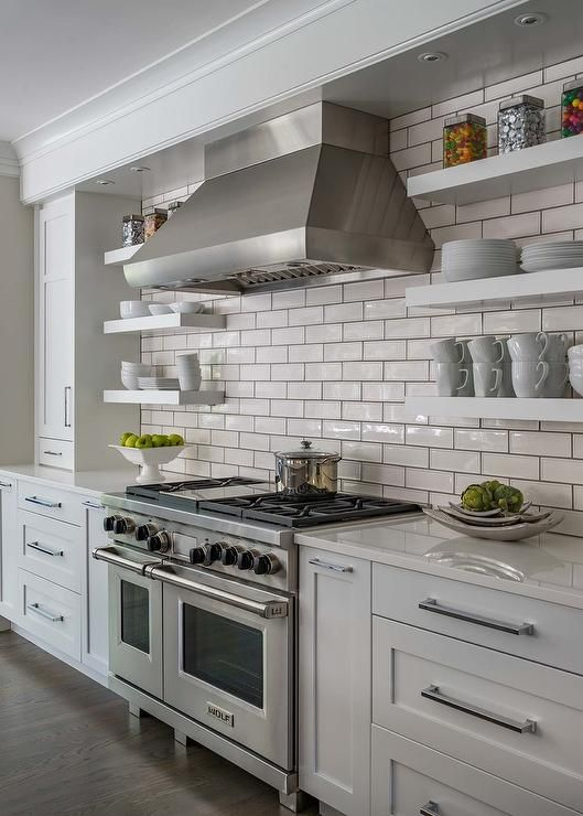 Well Appointed Light Gray And White Kitchen Boasts Stacked White Floating S White Kitchen Kitchens Without Upper Cabinets White Subway Tiles Kitchen Backsplash