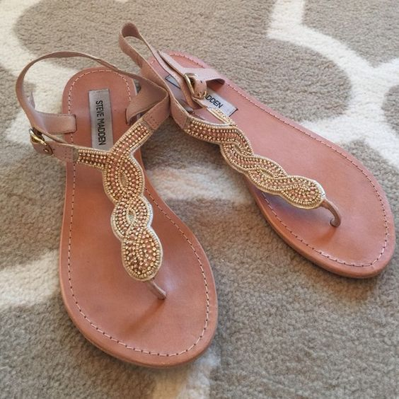 Steve Madden Nude/Gold Sandals Wore these once!! I love them they are just 1/2 size too small for me! They go with everything!!! No beads or stones missing!! In Great condition:) Steve Madden Shoes Sandals