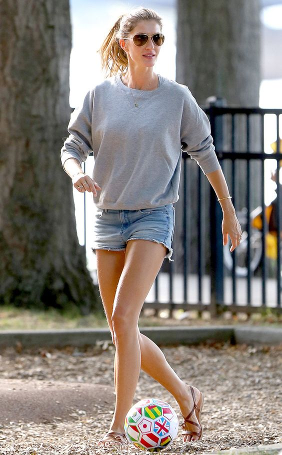Gisele Bundchen looked effortlessly cool in aviators, a casual gray sweatshirt and cut-off jean shorts while playing soccer at the park with her fam!