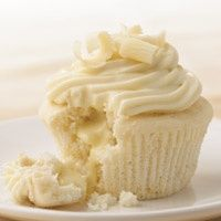 White Chocolate Cupcakes with Truffle Filling - just as they come out of the oven you snip the top of the cupcake and press a Lindt Truffle in the hot cupcake. Yum - Click image to find more Food & Drink Pinterest pins
