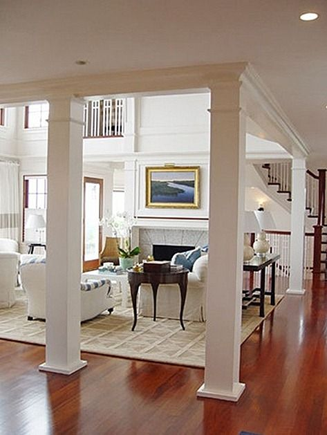 Love the interior columns and how it opens up to the second floor