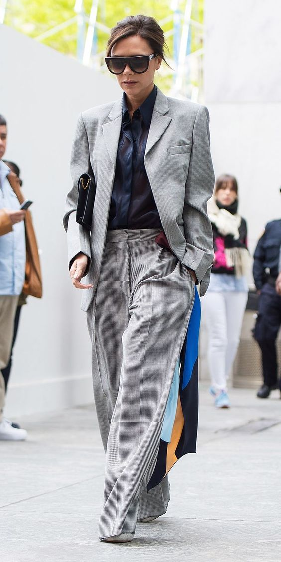 Victoria Beckham in a gorgeous relaxed suit. This would be a great option to wear to work for multiple industries: fashion, finance, etc! To a meeting with an investor or board member as well!