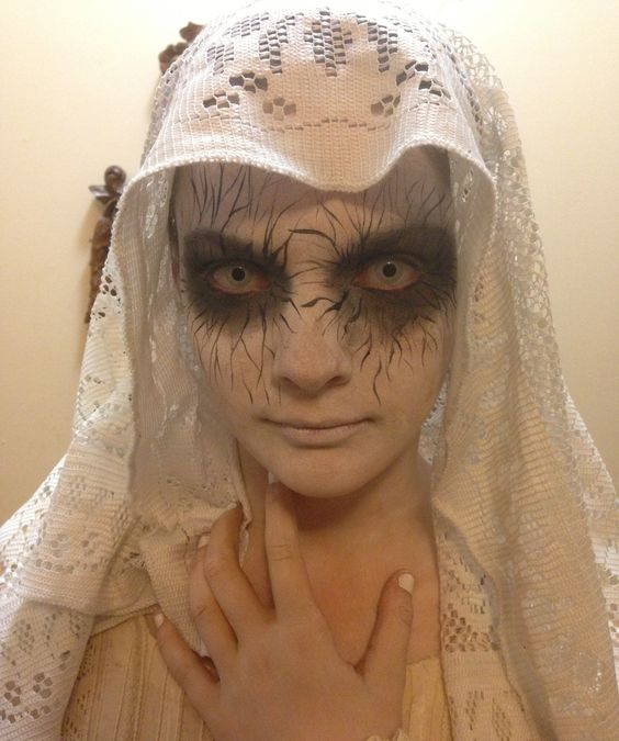 Super quick and EASY Halloween Costume  $2 Liquid Eyeliner, $2 black eyeshadow, White Face Paint, white contacts (optional)  Old dress and piece of lace curtain