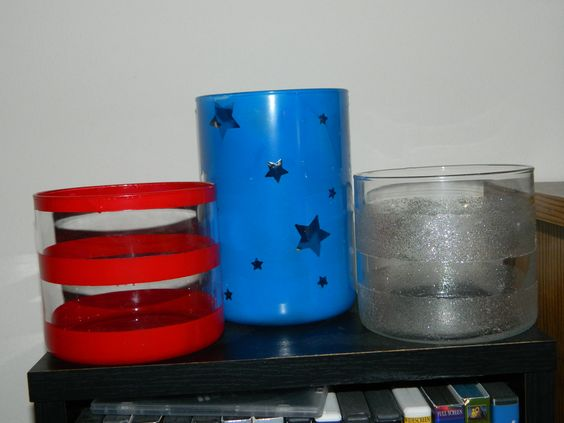 Old candle holders painted with spray paint. Red- painter's tape; Blue - star stickers; Silver - modge podge mixed with glitter