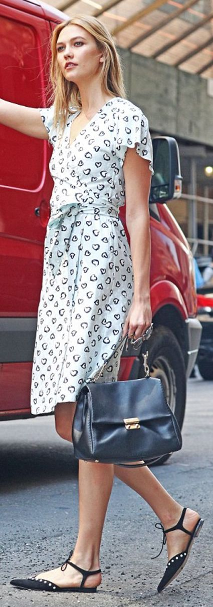 Karlie Kloss wearing Bion, Carolina Herrera and Vanessa Seward