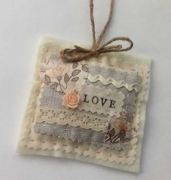 'Love'  Hanger - Linen, lace and vintage fabric.  This looks like it'd be a fun craft or something