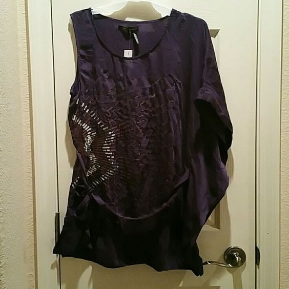 Purple One Shoulder Batwing Shirt (Juniors) Beautiful purple half sleeveless half batwing shirt that ties around the waist.  Extremely cute.  Perfect for a night out paired with leggings, jeans or a skirt and boots.  100% Polyester. Marineblu Tops